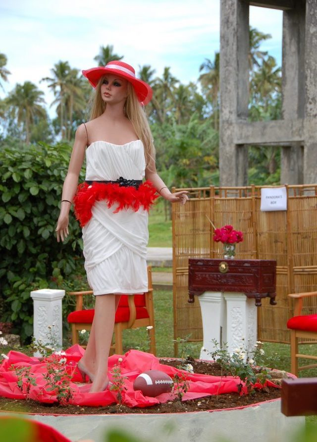 """Ikale Tahi luncheon adorned with random red-and-white objects, such as this, the inexplicable """"Pandora's Box"""""""