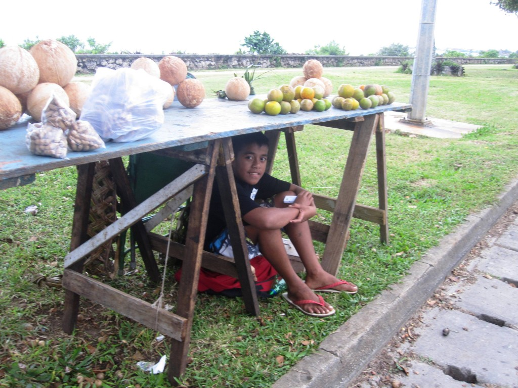 Boy selling Peanuts and Coconuts ready to drink