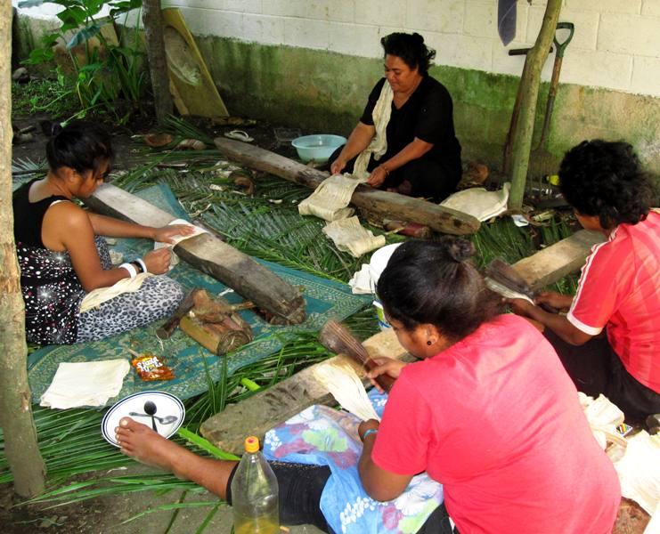 Beating bark to make tapa cloth strips.Tonga