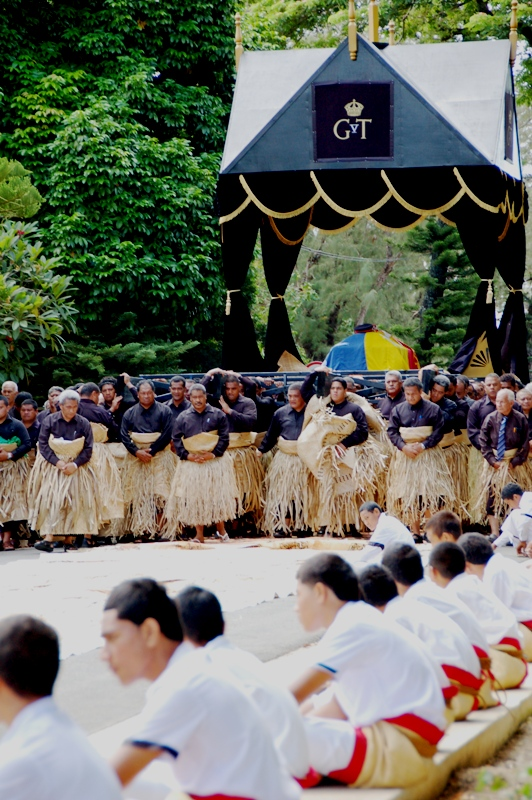 Carrying King George Tupou V across tapa cloth.funeral procession in Nukualofa Tonga