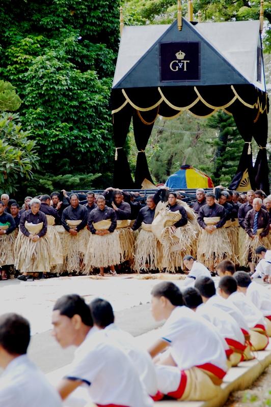 Carrying King George Tupou V across tapa cloth.funeral procession in Nukualofa Tonga