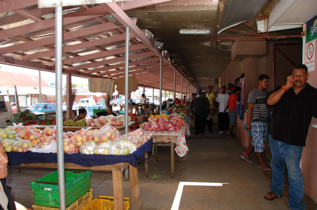 Outside Market, bags of Apples and Oranges (imported)