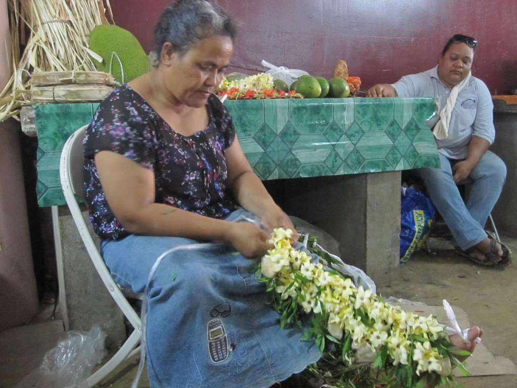 Woman Braiding Garland at Meketi Talamahu