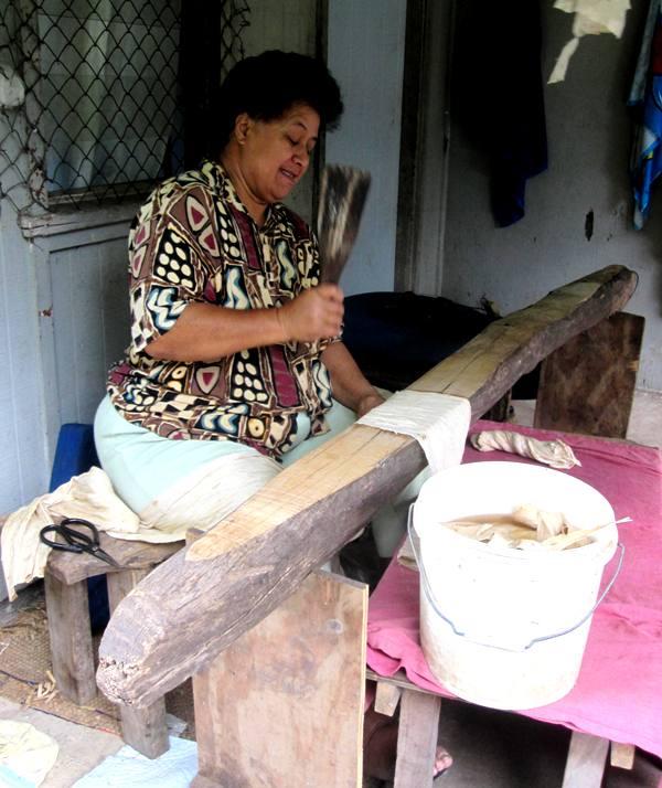 Kaloni beating TuTu with an Ika.Tapa Making in Tonga