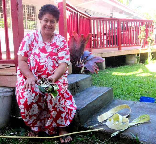 mulberry bark separated and peeled.Tapa Making in Tonga