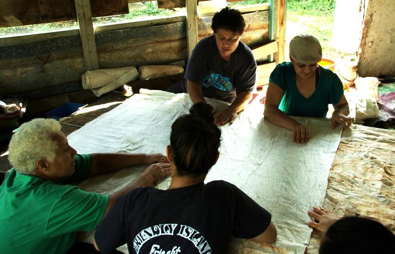 Tapa Making in Kava Hut; double lining tapa cloth. Nuku'alofa, Tonga