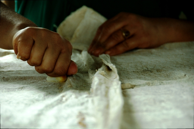 Coating underlying tapa cloth with starch to use as glue for patching