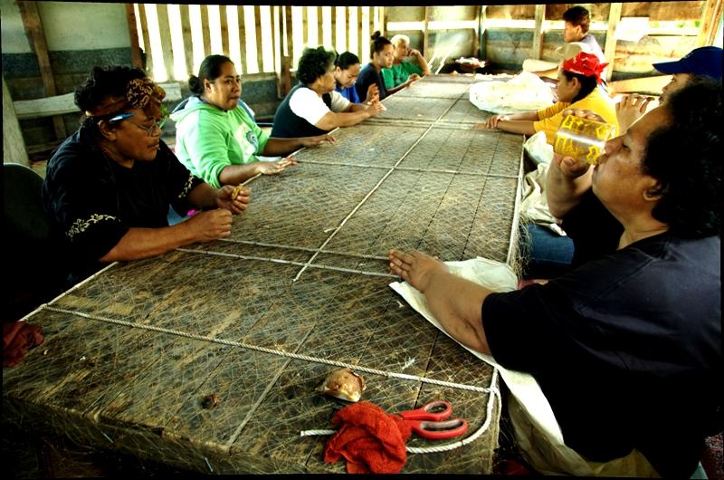 Tapa making in kava hut. Nuku'alofa, Tonga