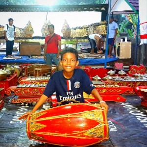 Party time! Boy setting up drum for gamelon orchestra athellip