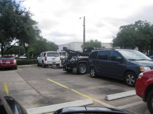Tow truck at the parking lot adjacent to the Houston Chinese Consulate