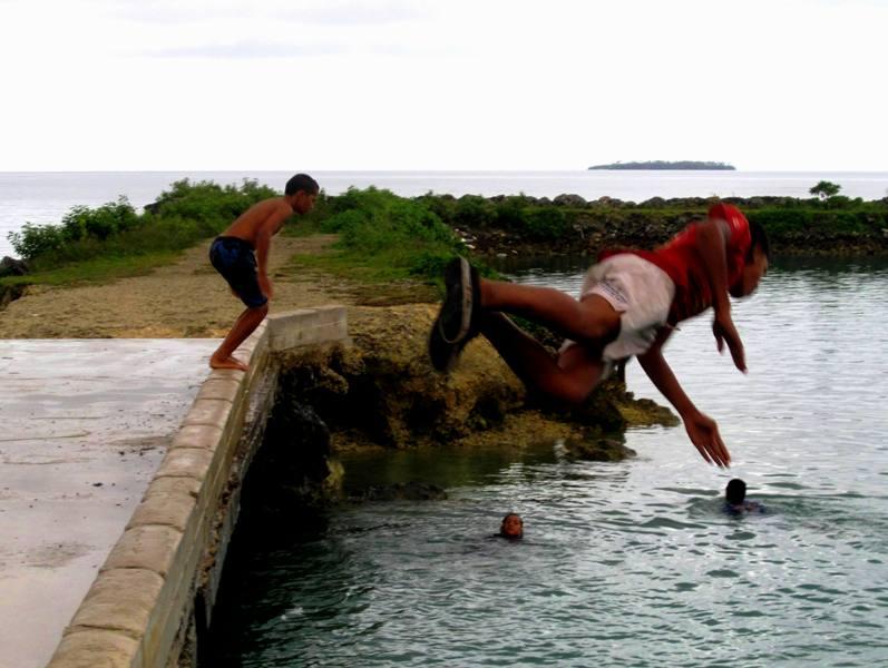 Diving at outdoor swimming pool.Vuna Road