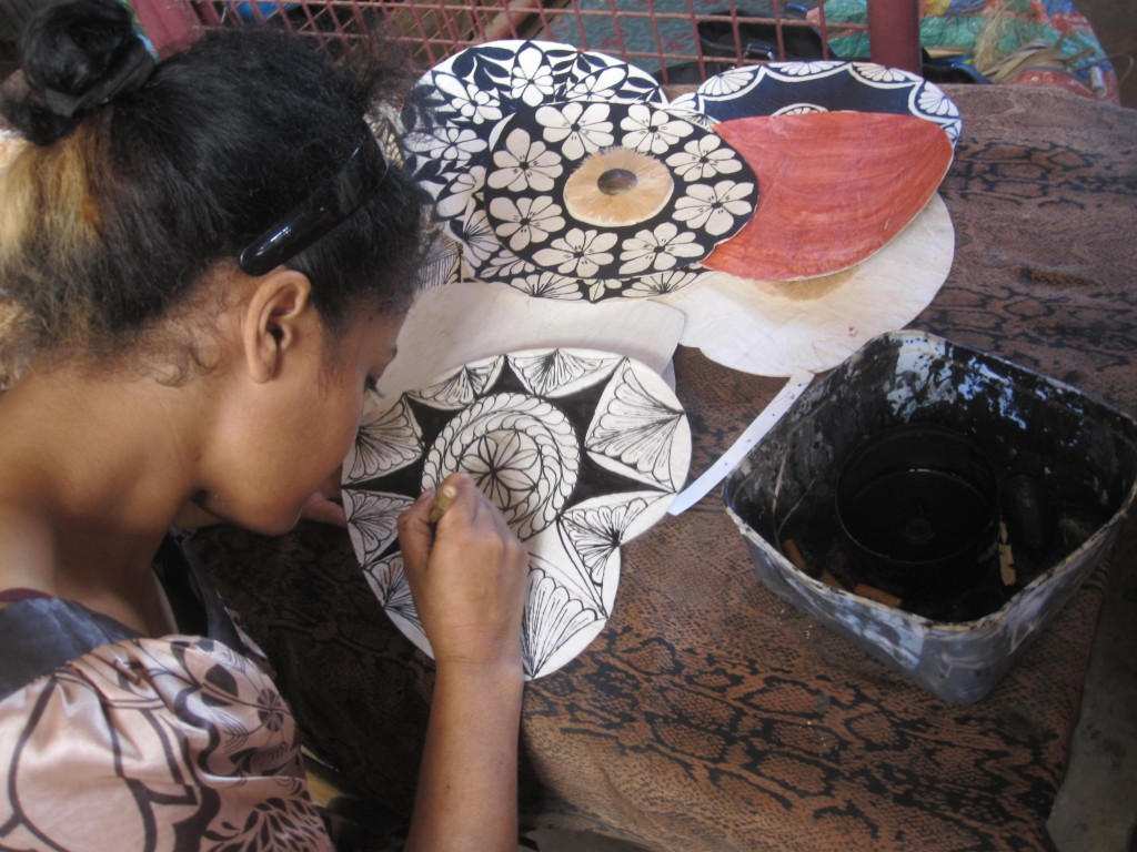 Girl painting Tapa Fans