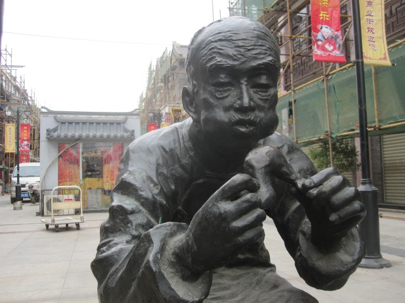 Bronze statue at Ancient Cultural Street in Tianjin, China