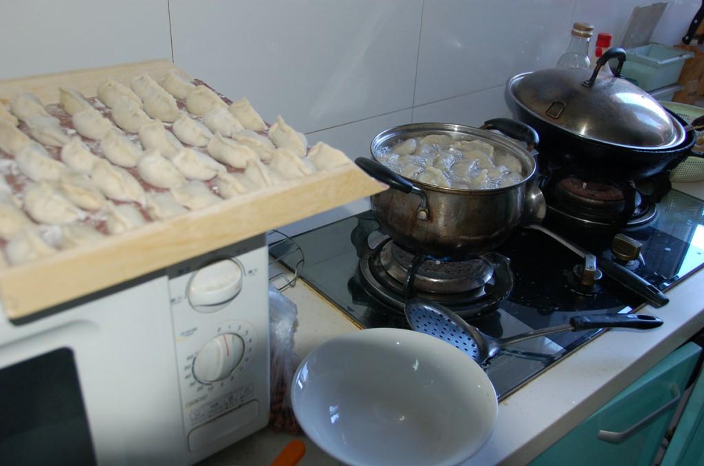 Boiling Chinese Dumplings.How to make Chinese Dumplings.Jiaozi