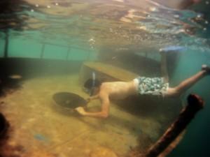 Snorkeling to the shipwreck at Pangai