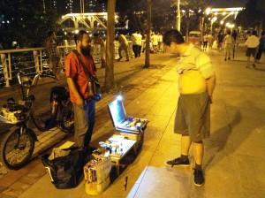 Vendors along Haihe River at night