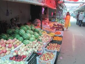 Walking my bike through a fresh market