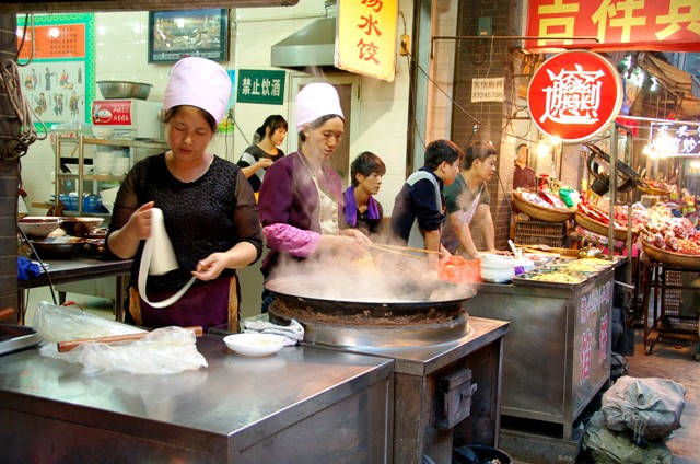 Xi'an Muslim Quarter.Women making noodles
