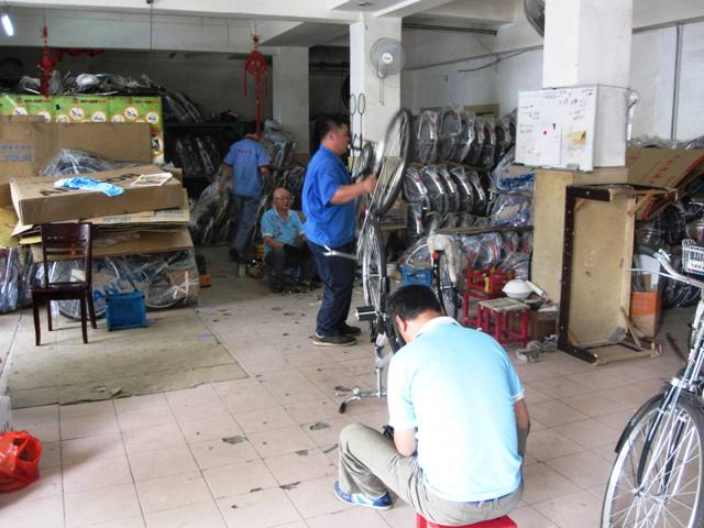 Assembling Bicycles, Binjiang Dao Shop