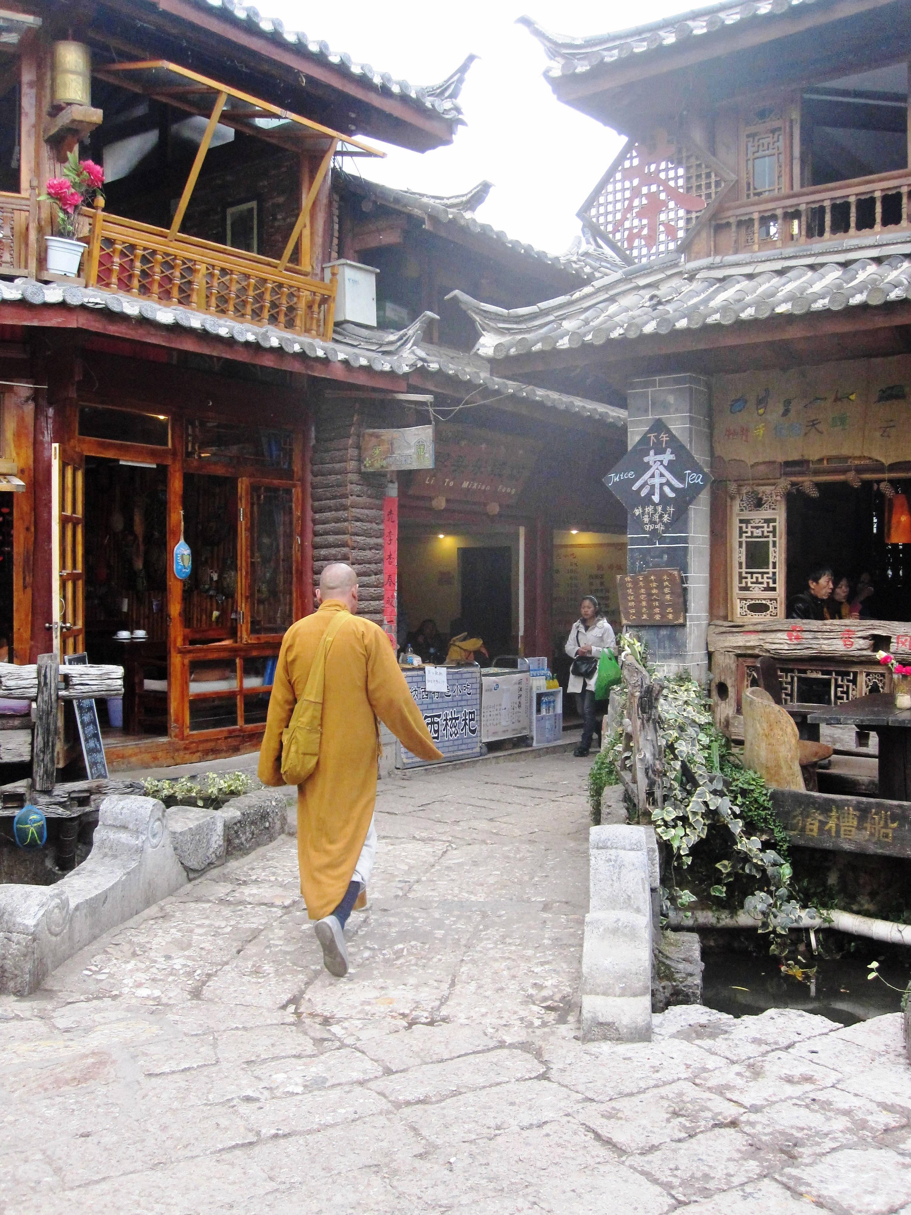 Monk Walking through Old Town (Lijiang)