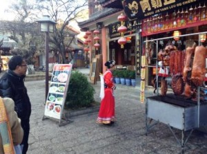 Waitress in local costume.Lijiang