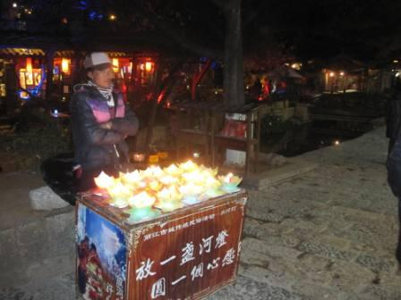 Styrofoam boats with candles.lijiang