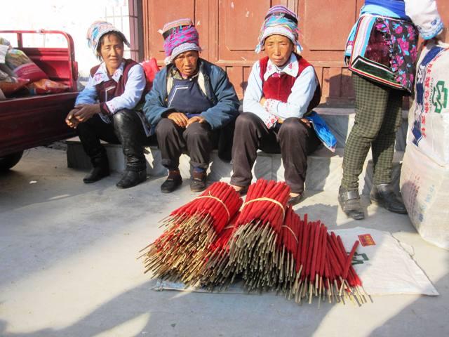 Women selling incense at village market. Erhai Lake