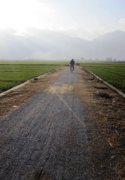 Riding through fields (leaving Erhai Lake to return to Dali).