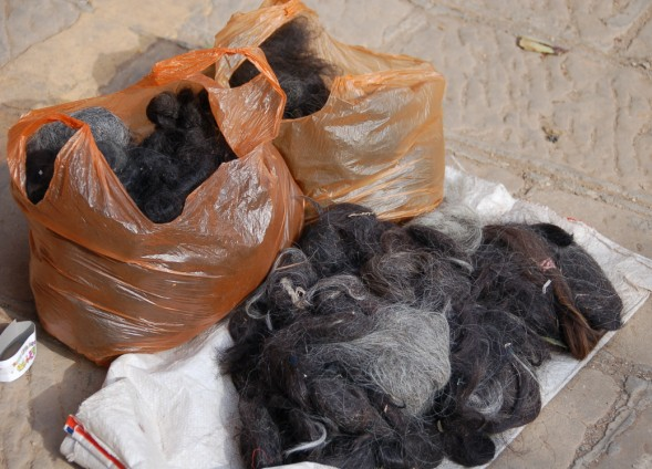 Shaxi Friday Market.  Bags of Hair!