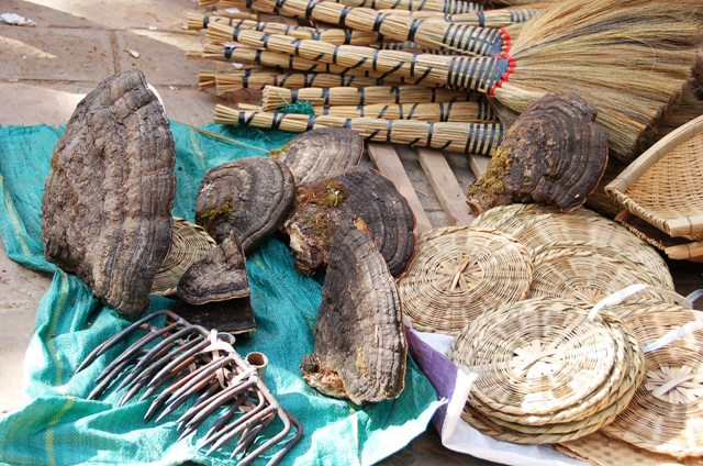 Shaxi Friday Market,: Nothing goes with baskets, brooms and rakes like a nice selection of fungus.