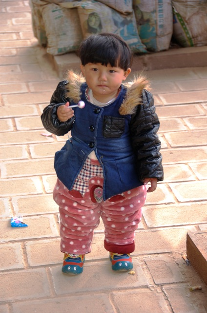 Little Girl with Lollipop in downtown Shaxi.
