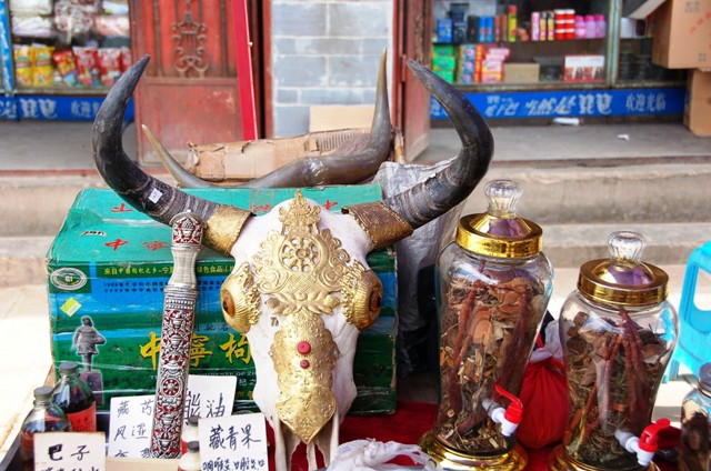 Shaxi Market Stall on Main Street Selling Traditional Medicine.