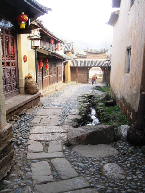 Shaxi Old Town (if you're coming into town, you'll most likely enter via the main road.  Take a left down the cobblestone side-street to visit the Old Town area and   Square.