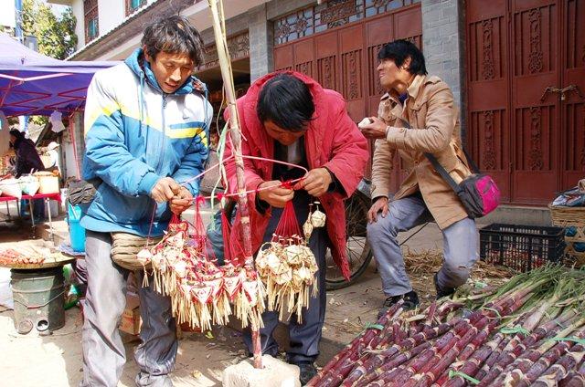 Straw Ornaments and Sugar Cane.Shaxi Friday Market