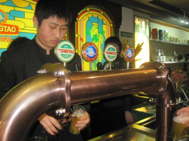 Tsingtao Brewery Sampling Room. The Red and Blue logo is the unfiltered tap.