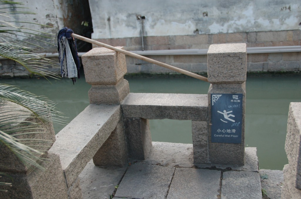 Slip-and-fall mitigation at its best. You'll want to zoom in on the sign, probably. English language signs in China