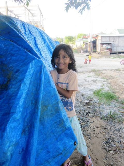 Girl with Blue Tarp