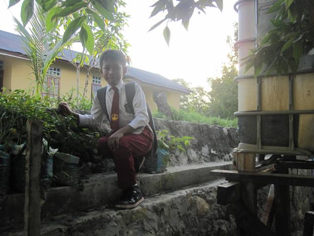 School Boy next to Watertank