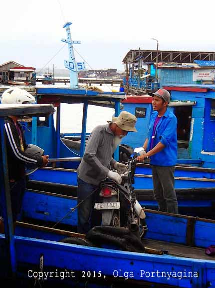 Motorcycle? No Problem! Loading bikes onto Penajam Water Taxi