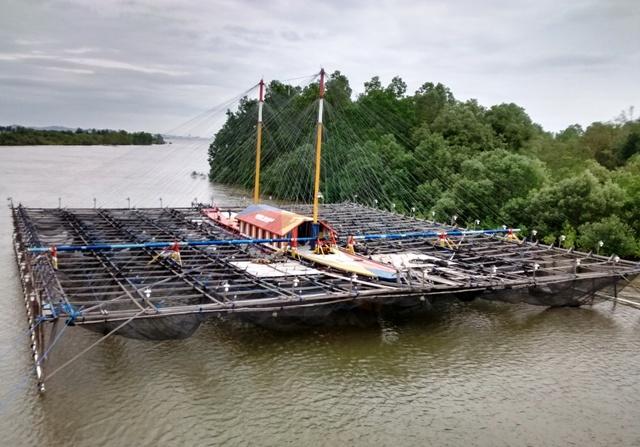 Floating Fish Plant (under bridge). Penajam, Indonesia