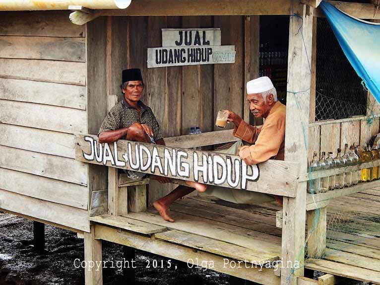"""""""Live Shrimp for Sale"""" Hut over fish and shrimp farms. Penajam, Indonesia"""