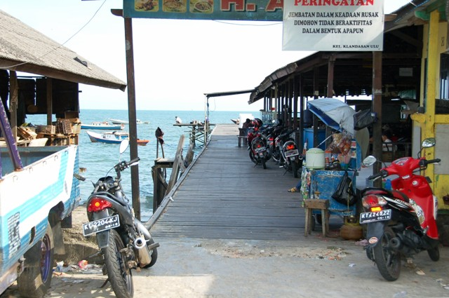 Backside of Klandasan; where they slaughter chickens (to left) and sell grilled fish (at right)
