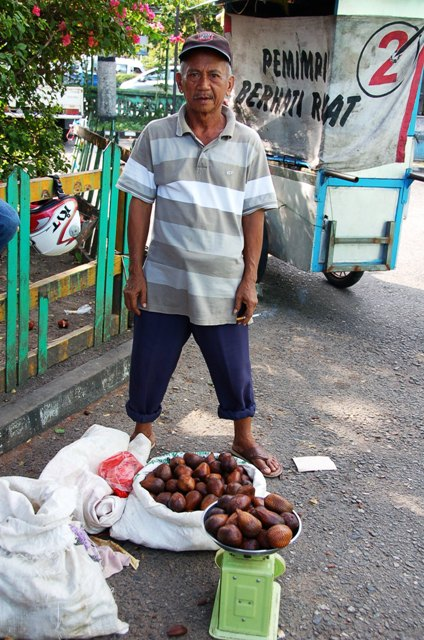 Man selling salak (snake fruit)
