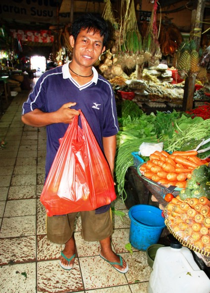 Pak Ridwan carrying my groceries so far. A lot of men and boys will ask to carry your goods. In exchange, you give them $10,000 IRD (under 1 USD) for their help. They are always really nice and can point you in the direction of a certain vendor if you aren't sure where to go for something.