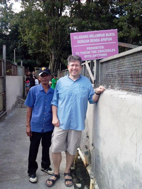 Sam and Pak Nurul (our driver) at Crocodile Farm. Love the sign!