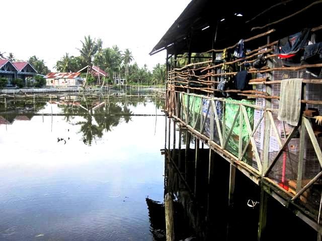 House next to fish farms.Manggar Beach