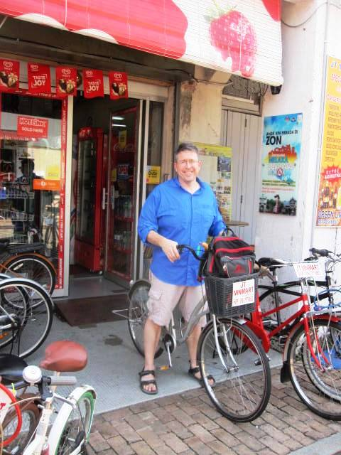 Renting bikes off Jonker Street. These clunky things are great fun to wobble through town on, and a fantastic deal at only 3 Ringgit per hour!