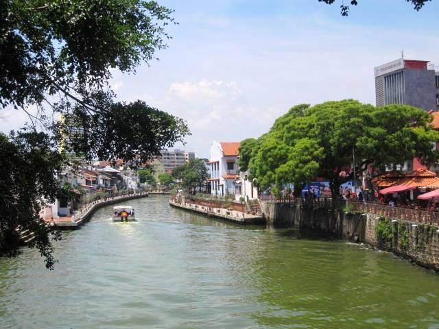 Crossing Melaka River to Jonker Street. Many boat cruises (included a Duck tour!) chug through the waters.