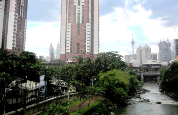 View of KL from the confluence of Gombak and Klong Rivers, the birthplace of the city. See the twin towers in the distance? And parallel to the ground, you may be able to make out KL's elevated rail line...