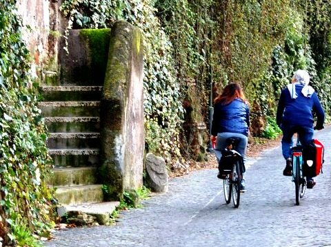 Appian Way leading to park from town.Rome Italy